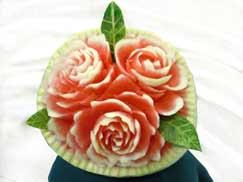 fruit carving, fruit sculpture, fruit centerpieces, fruit bouquets, edible centerpieces